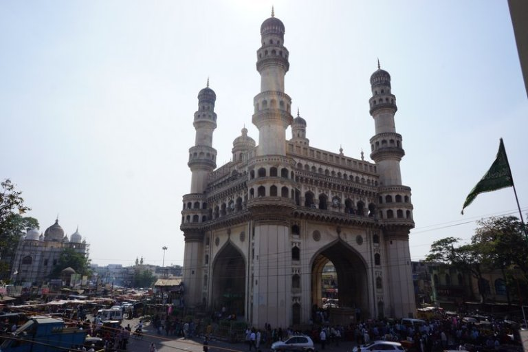 "In Hyderabad we wandered around the hot and bustling markets in the old city enclosed by the ""Char Minar,"" or four gates."