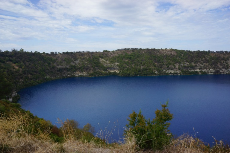 Blue Lake.  The lake has fascinated scientists as it changes from blue to grey and back again over the course of a few days each year.  They still don't know how it does this transformation.  It is a lake in an old volcanic crater and the city gets it's water supply from the lake. The deep blue looks unreal