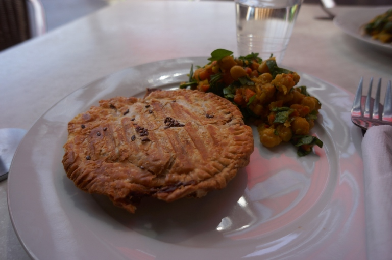 """Vegan savory """"pie"""" filled with veggies at BeanGreen Cafe, a veggie place."""