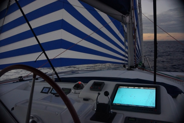 "Flying through the water with the ""code-zero"" sail billowing off he side of the boat and the radar screen showing nothing but deep blue sea."