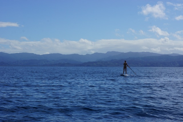 Alison paddle boarding out in the larger bay where we spent three days playing in the sun.