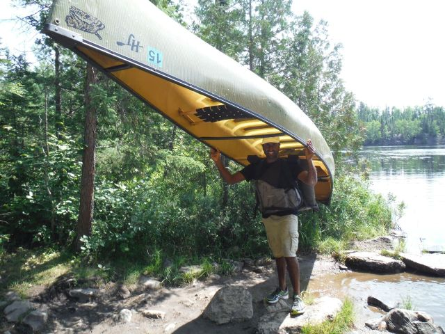 Ravi portaging the canoe and pack.