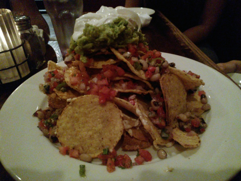 vegan nachos!!!! can't remember the name of the place...but it had a bookstore in the restaurant...it wasn't a strictly vegan place...but they had a ton of vegan options.