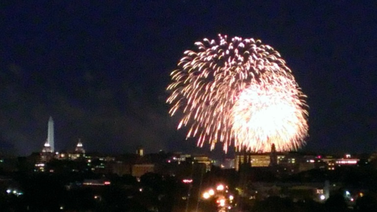 July 4th fireworks from a rooftop in Washington DC. Yes, that is the Washington Monument on the left.