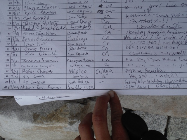 Signing the summit register at Mt. Whitney.