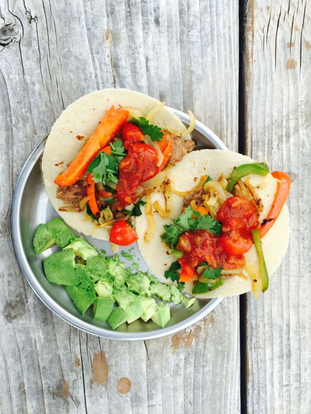 Camping dinner. Vegan fajitas! This is one of our go-to camping meals. Lots of fried veggies, beans, avocado, salsa and cilantro.